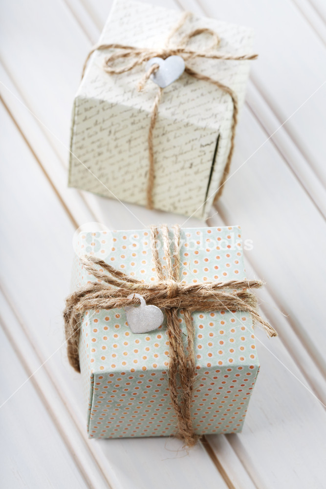 Handmade small present boxes with heart shaped tags
