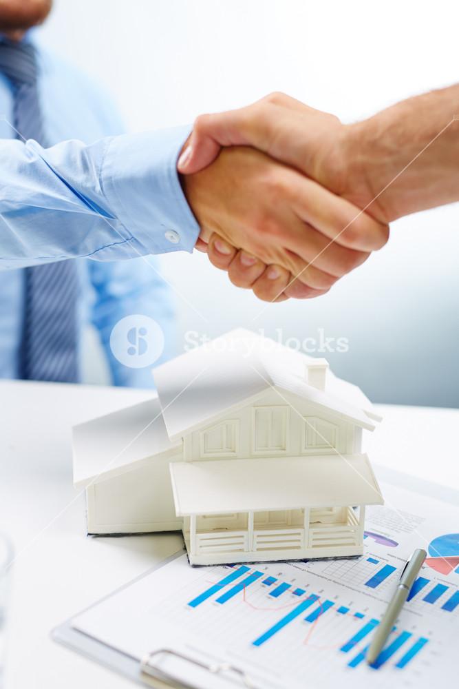 Handshake of buyer and vendor of real estate
