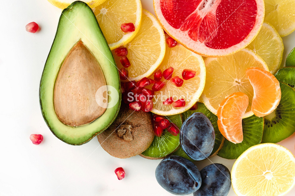Healthy fresh sliced fruits and citruses isolated on white background
