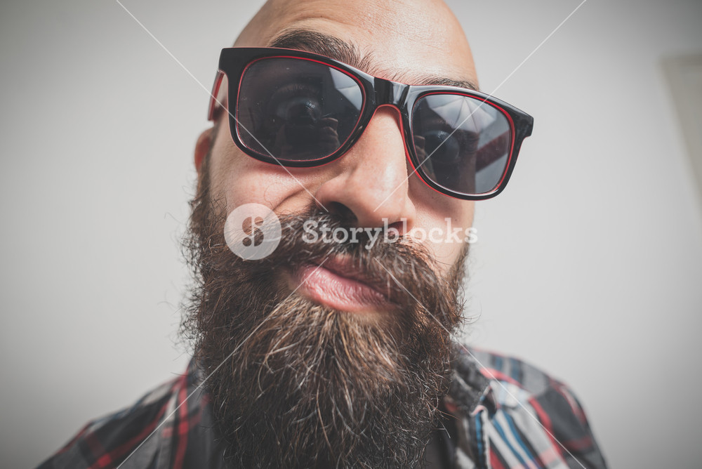 hipster long bearded and mustache man with shirt squares