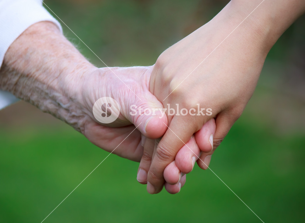 Holding hands with senior outside