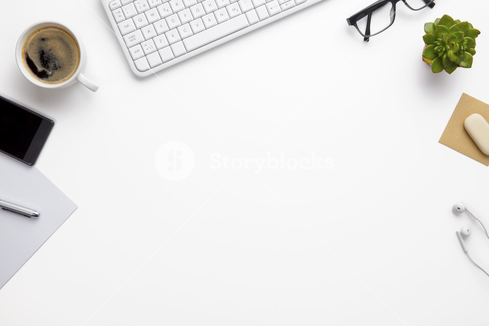 Devices And Office Supplies On White Desk Royalty Free Stock Image Storyblocks