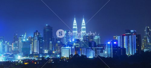 KUALA LUMPUR, MALAYSIA - AUGUST 27: Petronas Twin Towers at night on August 27, 2016 in Kuala Lumpur. Petronas Twin Towers were the tallest buildings (452 m) in the world from 1998 to 2004.