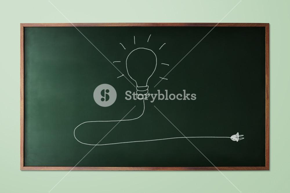 Light bulb  idea icon on chalk board. Chalk hand-drawn graphic style.