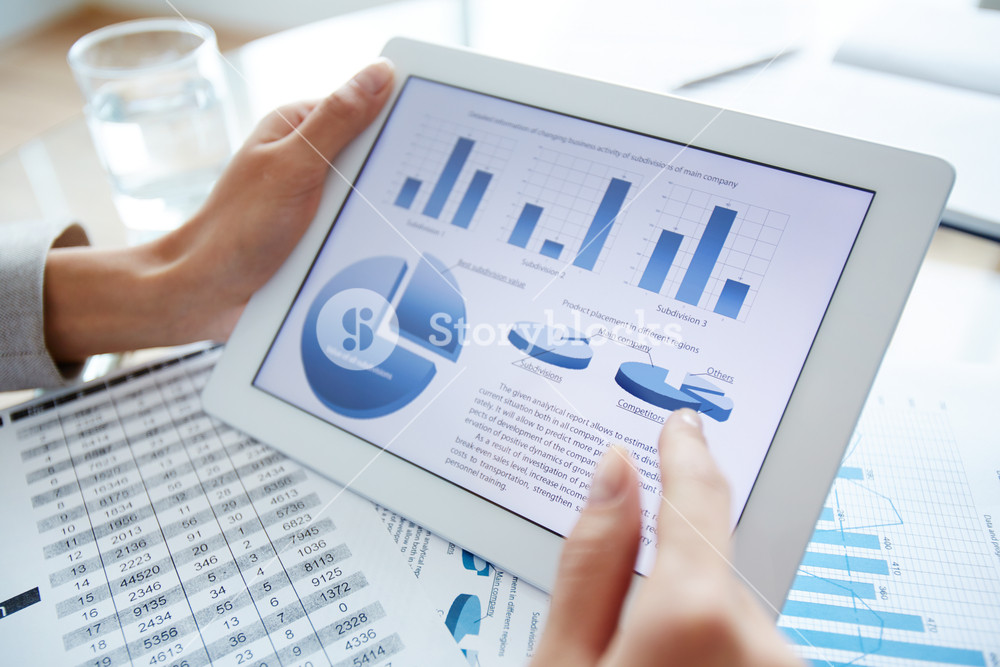 Marketing data in digital tablet and female hand over it