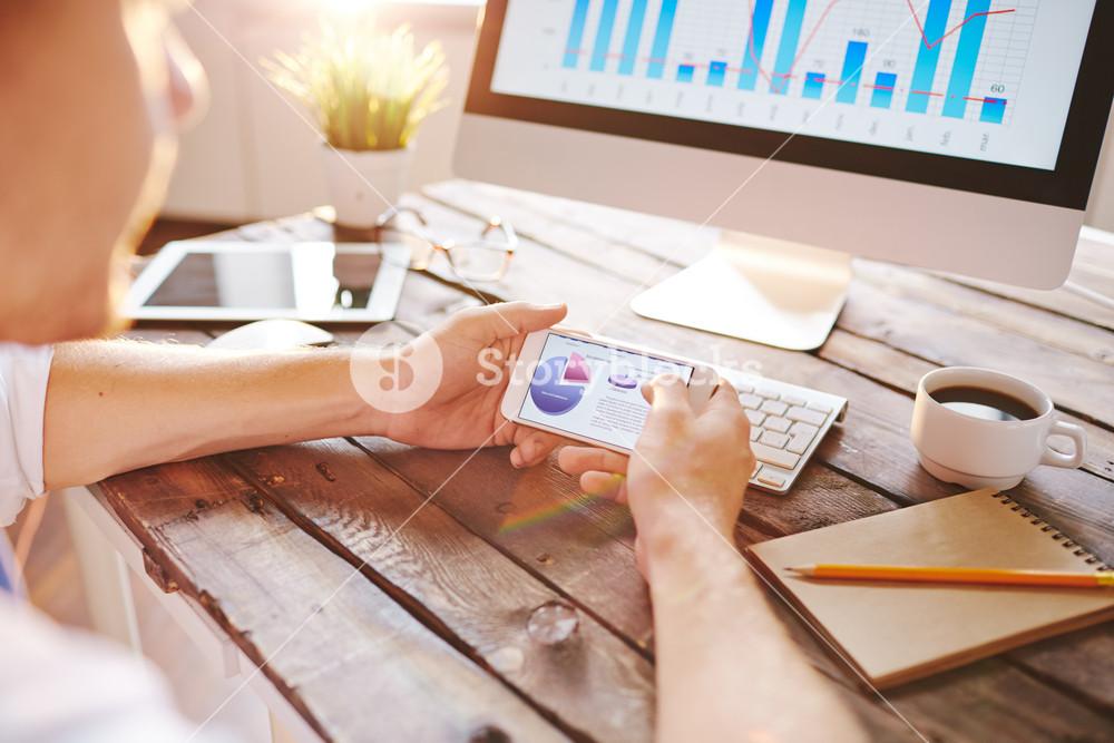 Marketing data in smartphone being analyzed by employee