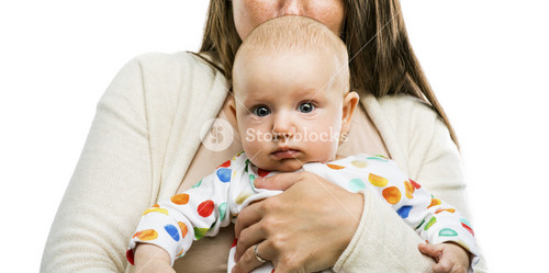 Mother holding a baby in her arms and kissing it isolated on white background