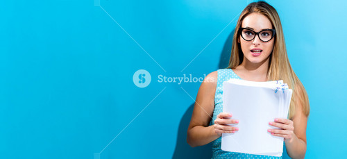 Office woman in glasses with a stack of documents