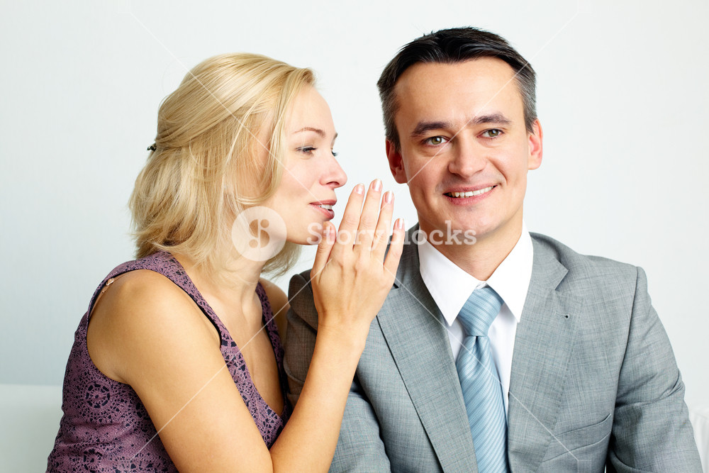 Photo of happy man and woman talking and laughing