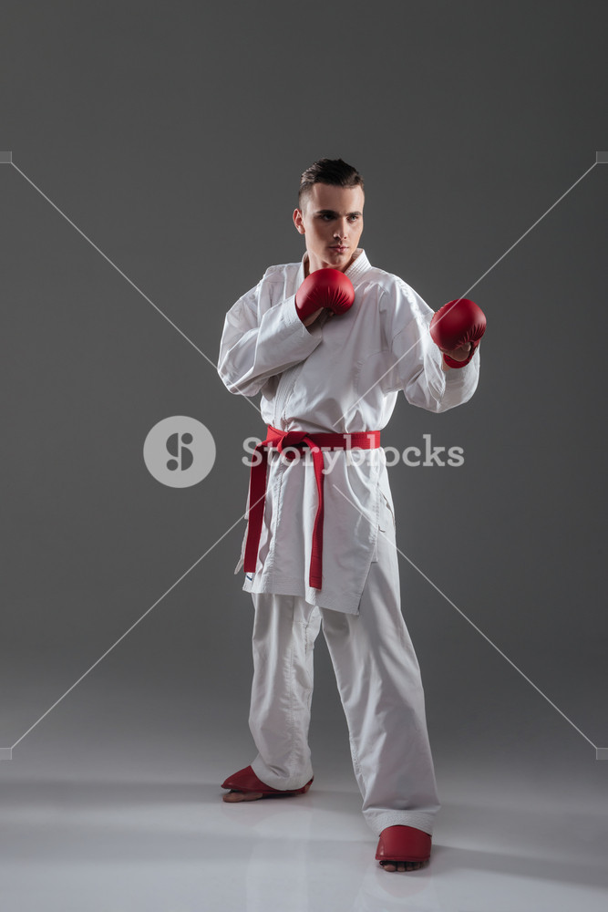 Picture of handsome young man in kimono practice in karate.