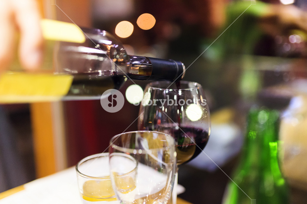 Pouring red wine into the glass in a restaurant