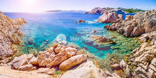 Pure clear azure sea water and amazing rocks on coast of Maddalena island, Sardinia, Italy