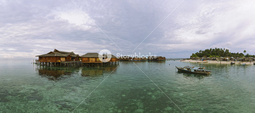 Resort and local Village at Mabul Island. This is a high resolution photo.