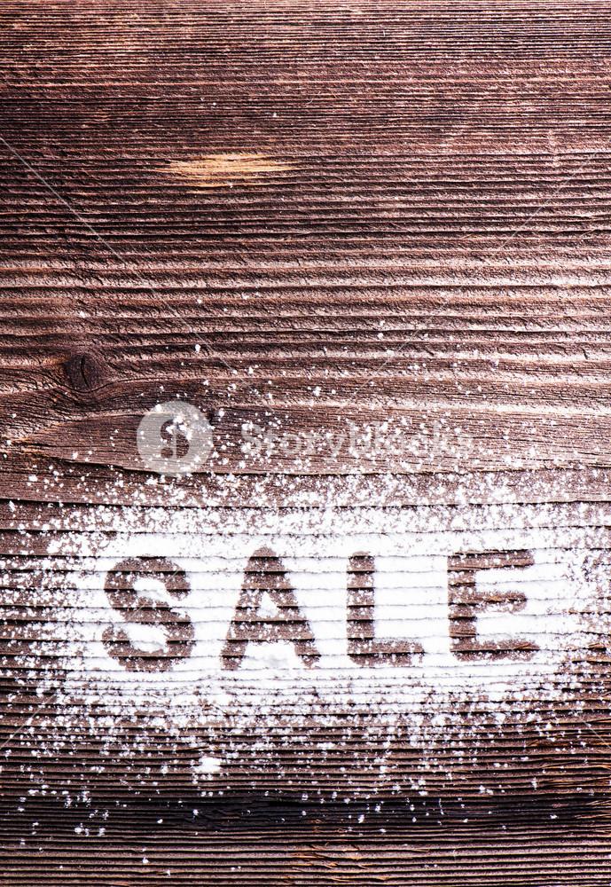Sale composition. Studio shot on wooden background.