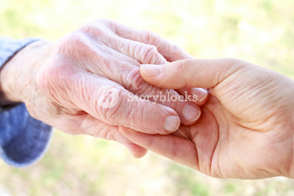 Senior and Young Women Holding Hands in Spring