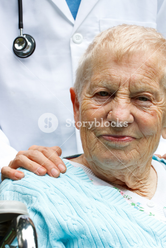Senior lady in wheelchair with her doctor