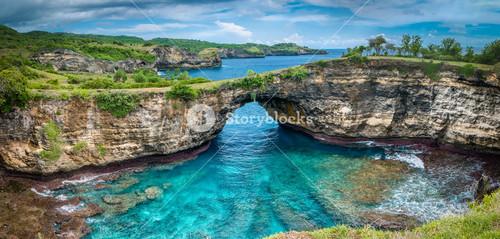Stone arch over the sea. Broken beach, Nusa Penida ,Indonesia.