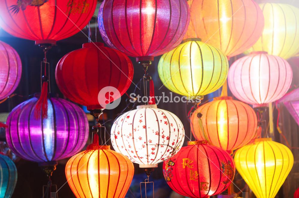 Traditional colorful silk lanterns at market street in Vietnam.