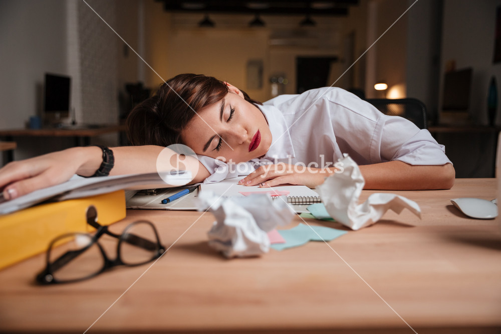 Weary business woman. sleeping on the table