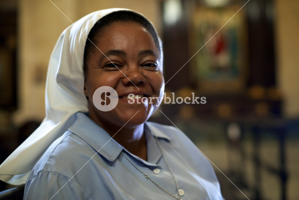 Woman and religion, portrait of catholic nun praying in church and looking at camera