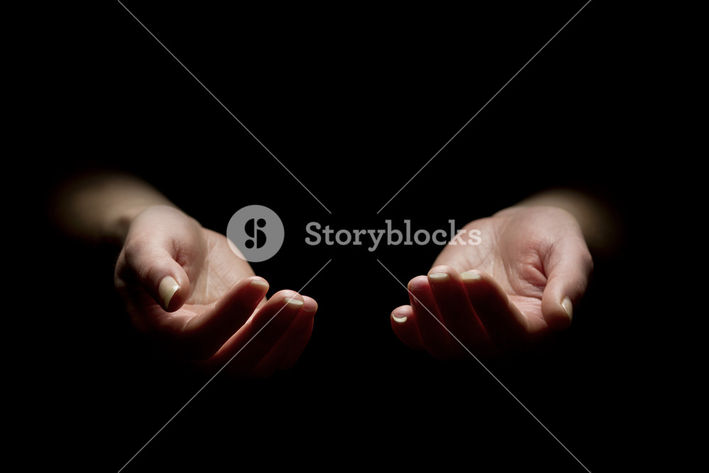 Woman begging with outstretched hands. Hands reaching out. Black and white.