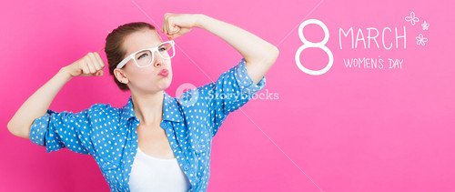 Women's Day text with happy young woman on a pink background