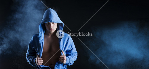 Young fitness fashion model is posing in studio on black background.