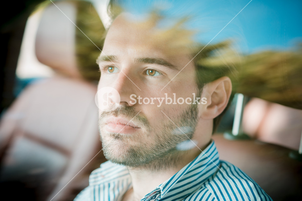 young handsome hipster modern man outdoor driving car in summertime