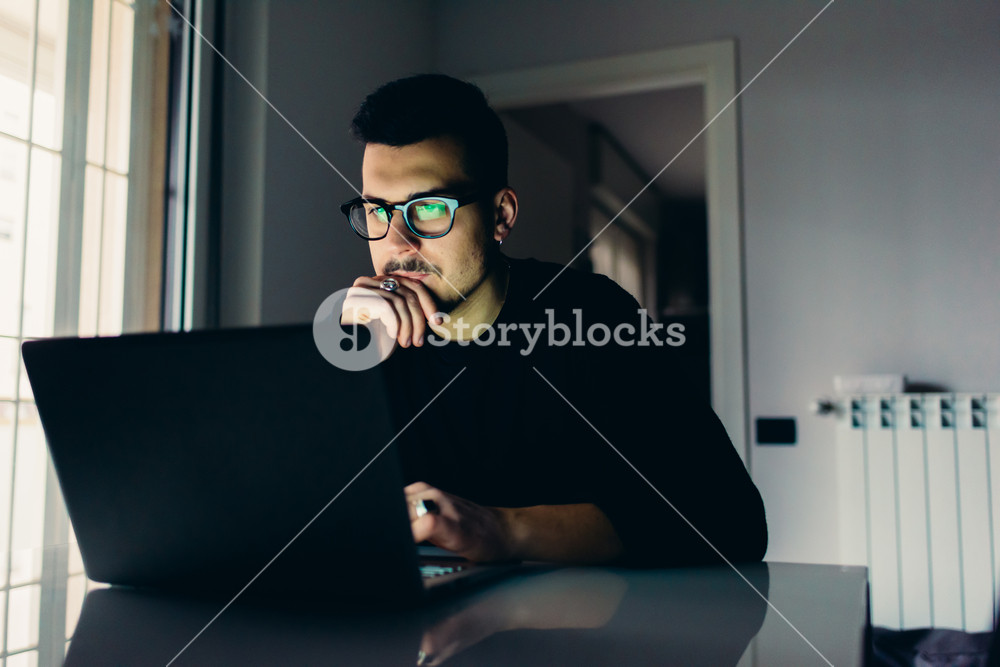 Young man indoor apartment using computer - business, customer, technology concept