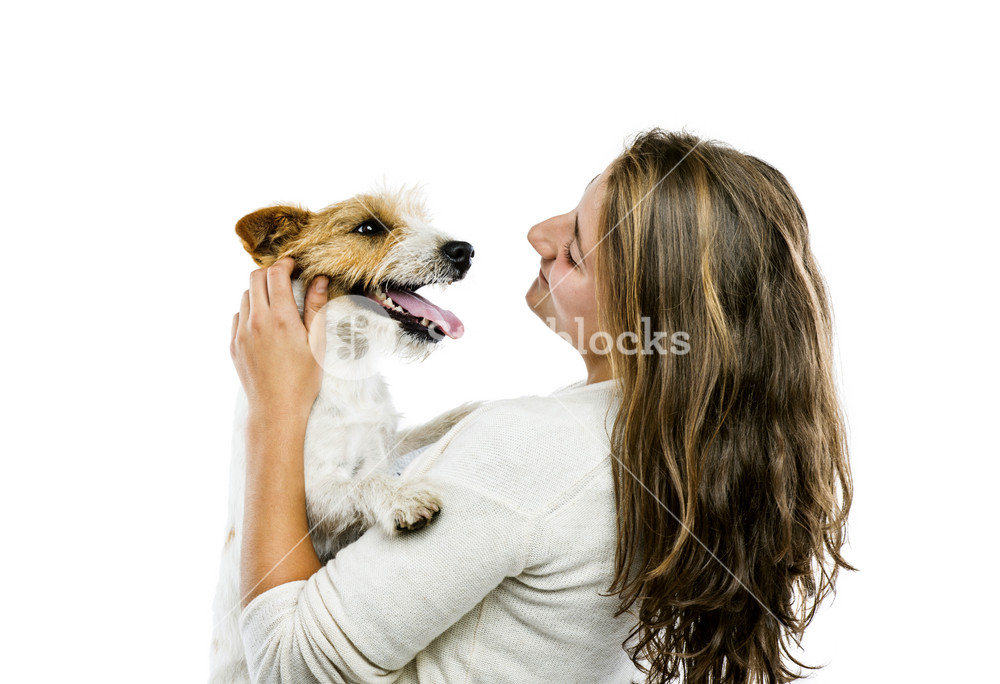 Young woman holding her cute parson russell terrier dog isolated on white background