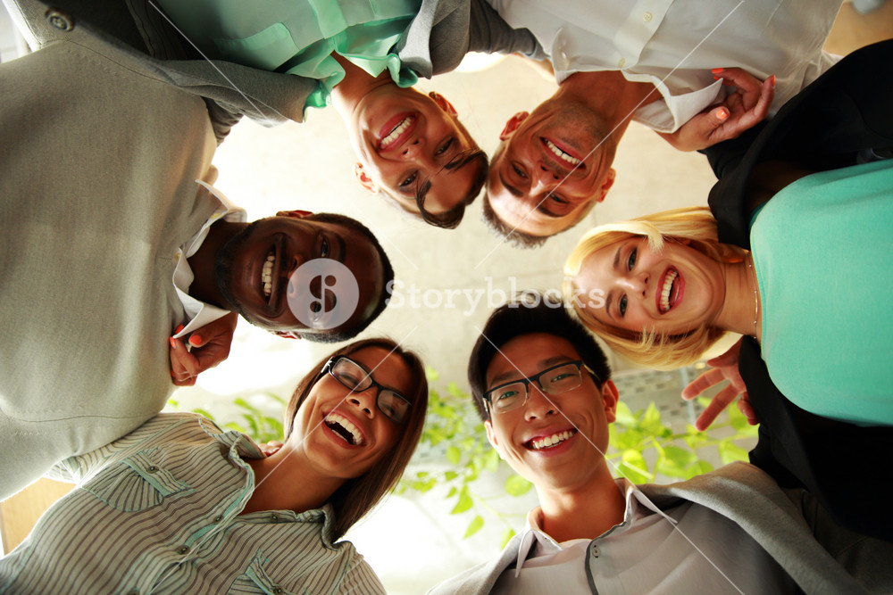 Happy business people with their heads together representing concept of ftiendship and teamwork