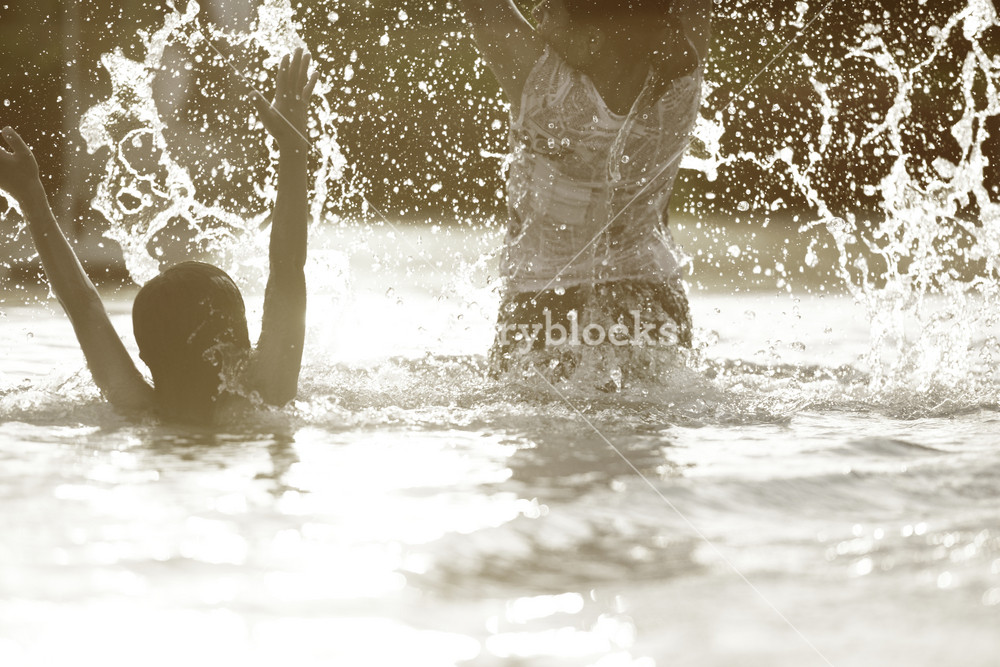 Happy children playing on hot summertime