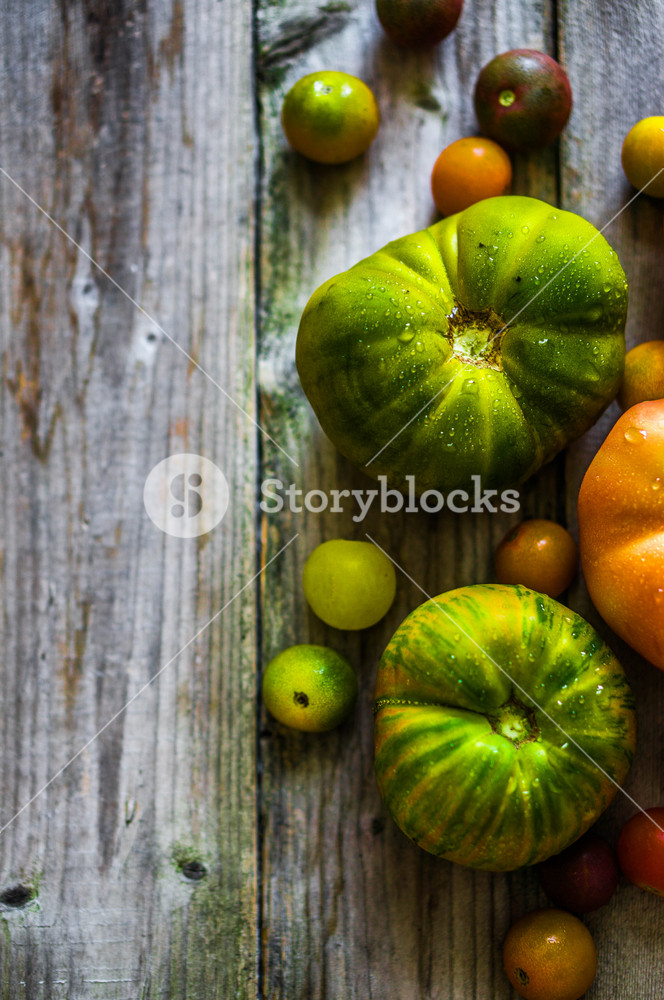 Heirloom Tomatoes On Rustic Background