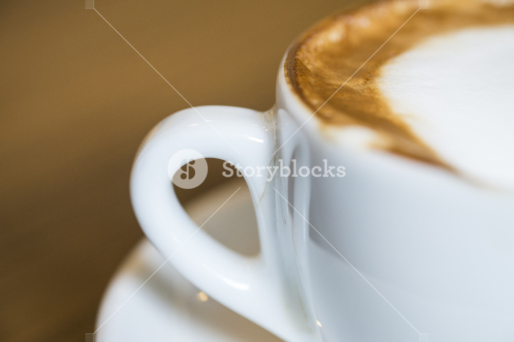 Hot Cappuccino with white cup on wood table coffee house