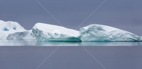 Icebergs against a grey sky