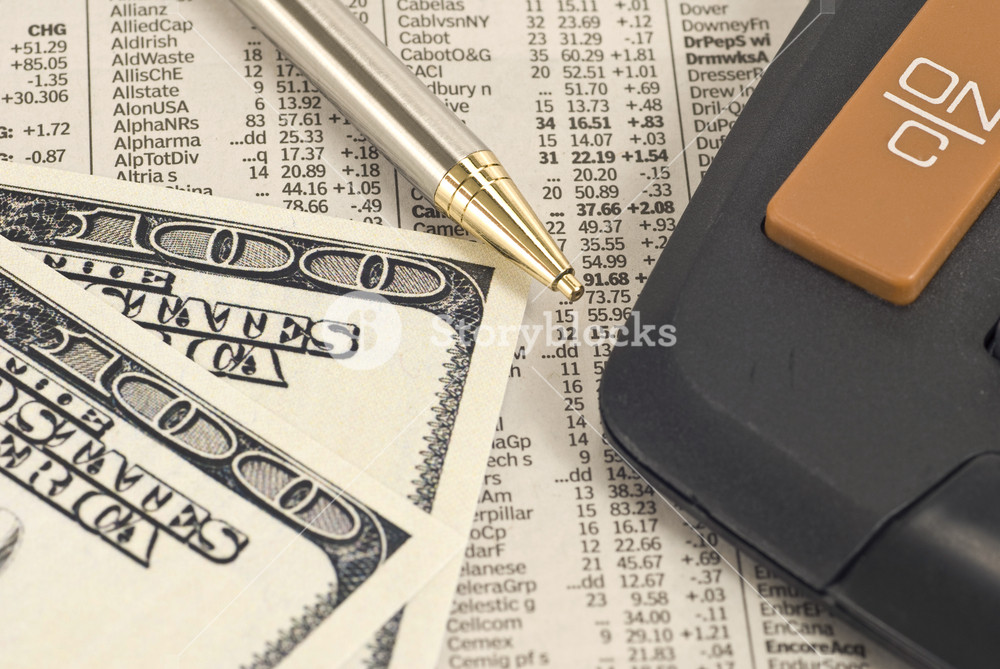 Image of Calculator With Money on Stock Report
