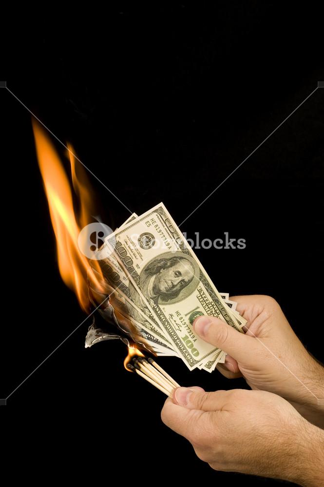 Match Setting Hundred Dollar Bills On Fire