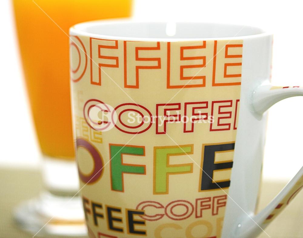 Mug Of Coffee And Glass Of Orange Juice