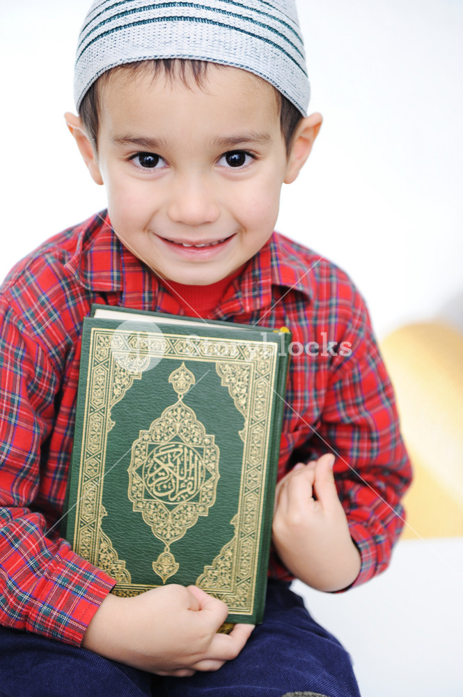 muslim kid with holy book koran royalty free stock image storyblocks https www storyblocks com business solution license comparison