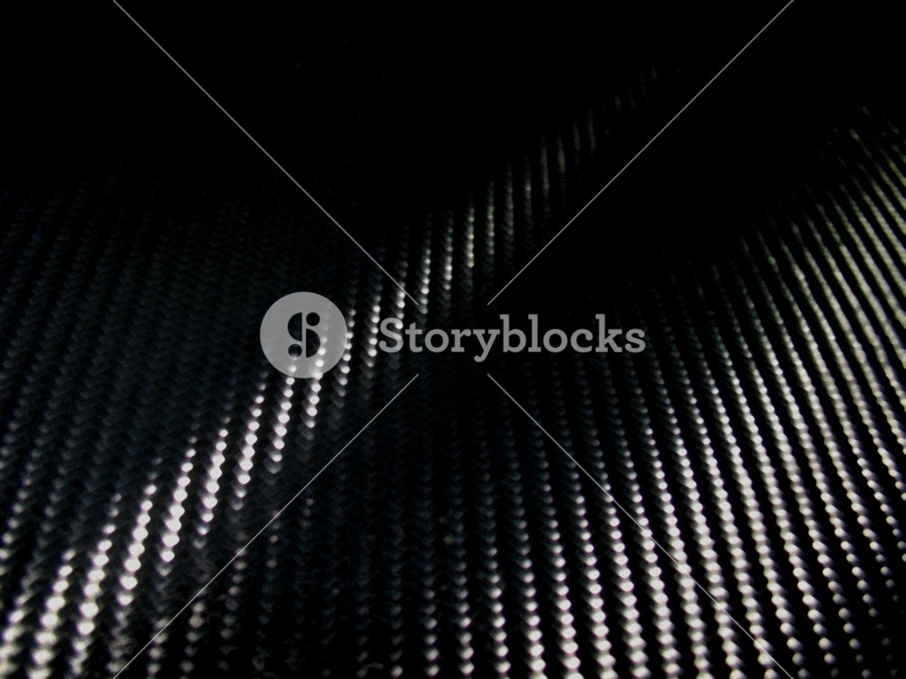 No fake stuff here...REAL high-res carbon fiber texture that you can apply in both print and web design.