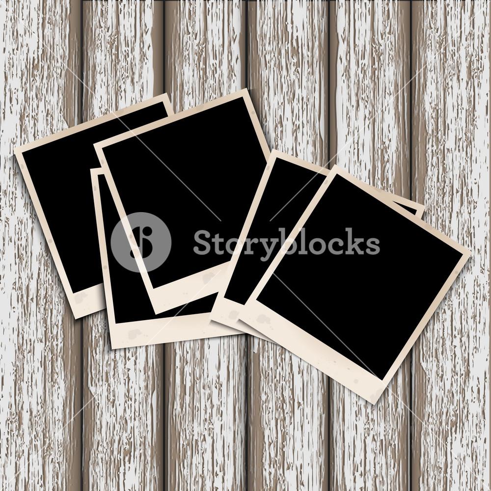 Old Photo Frames On Old Wooden Background