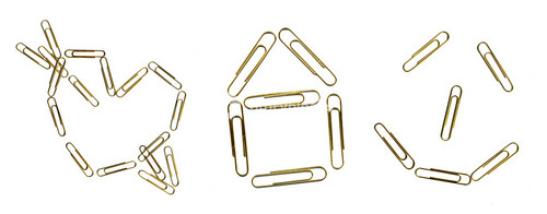Paper Clips Arranged In The Shape Of Heart