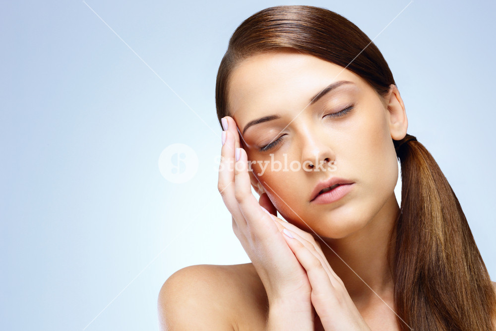 Portrait of relaxed young cute woman with closed eyes
