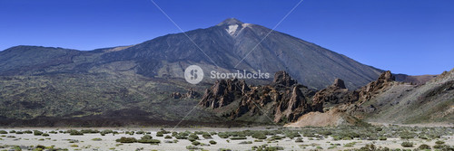 Rocky valley and mountain against a blue sky