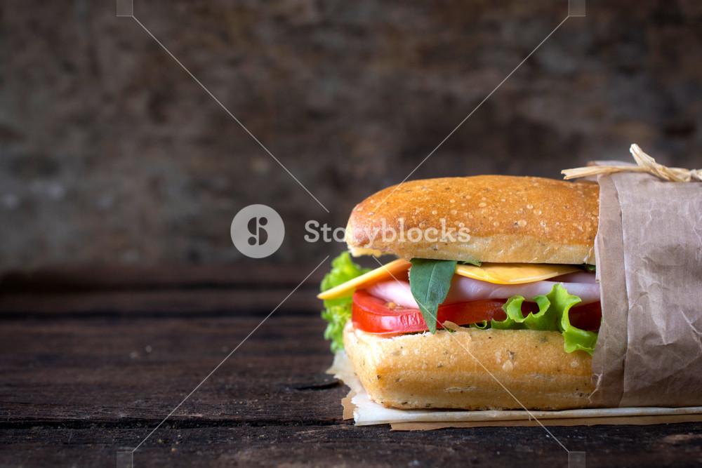 Sandwich On Wooden Background
