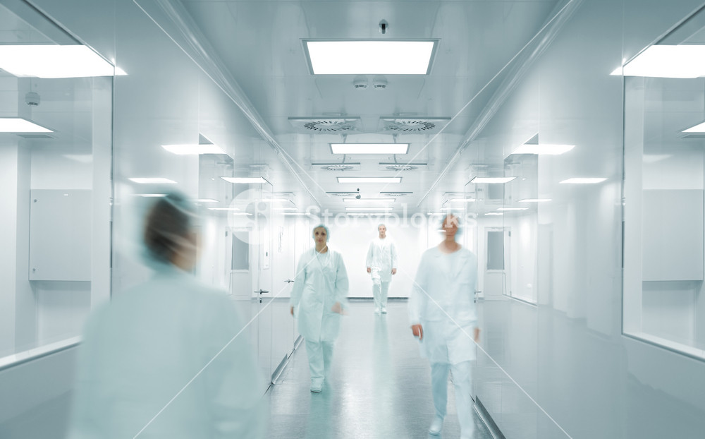 Scientists and doctors at modern pharmaceutical factory