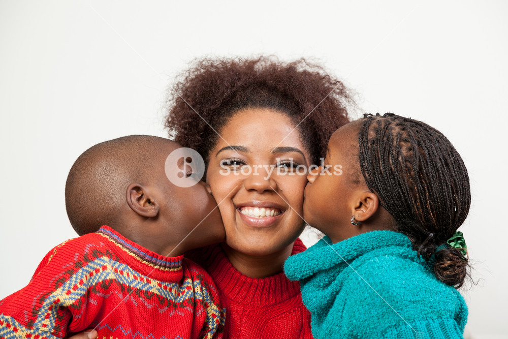 Son and daughter kissing her mother