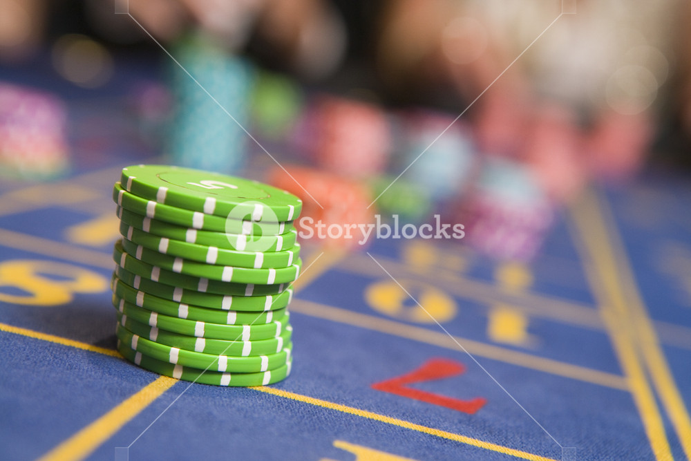 Stack of chips on roulette table in casino