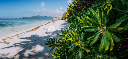 Anse Source d'Argent Paradise beach in the morning with view to Praslin Island on horizon, La Digue in Seychelles