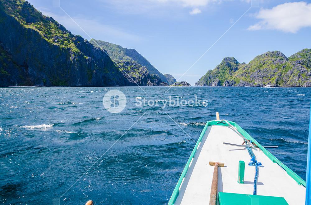 Banca Boat approaching Mantiloc Island on Windy Day, El, Nido, Palawan Philippines